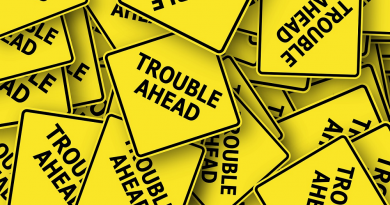 road-sign-trouble-ahead