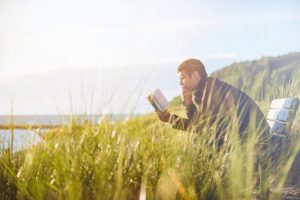 man-reading-in-nature