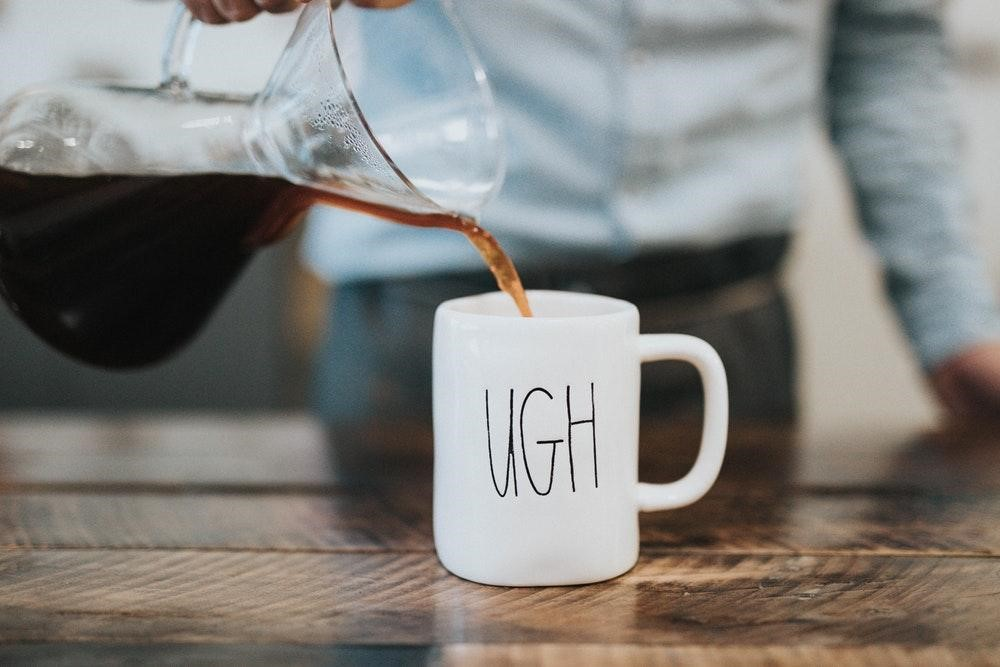 pouring-coffee-in-ugh-mug